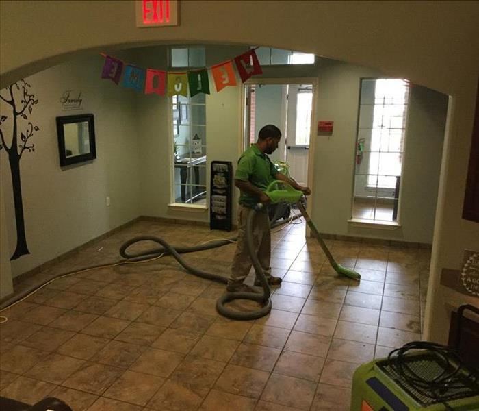 SERVPRO crew member extracting the water with our special equipment