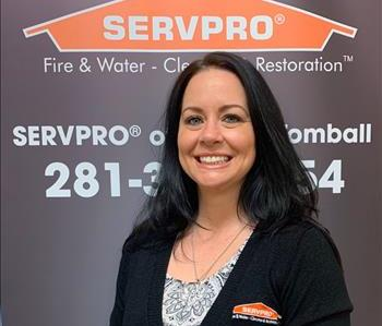 Head shot of an employee in front of our servpro backdrop.