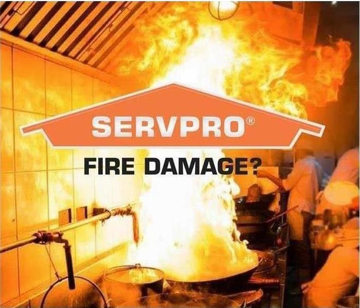 "huge flames in background burning down kitchen, servpro logo in middle of page, ""fire damage?"" under the logo"