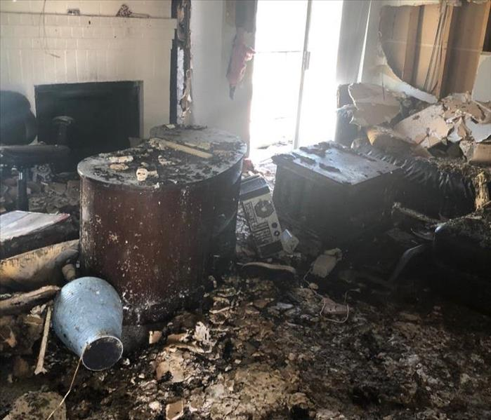 Apartment living room with severe fire damage.